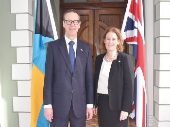 Sir Simon McDonald alongside and Sarah Dickson
